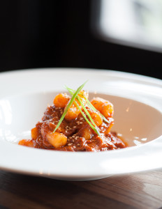 Underbelly's signature Korean braised goat and dumplings dish has been on the menu since their doors opened. (Photo: Julie Soefer)